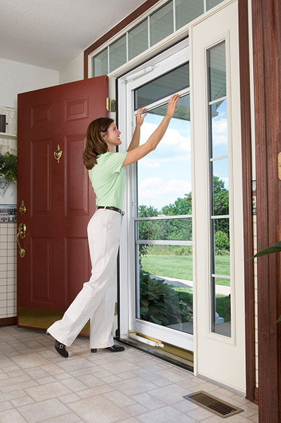 retractable screens on a spectrum storm door