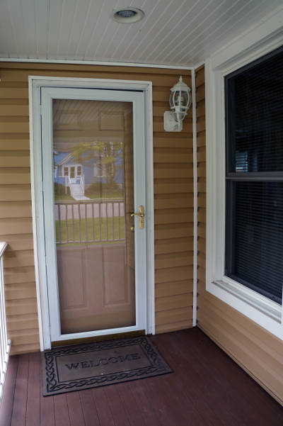 Benefits of installing storm doors for Front door with storm door
