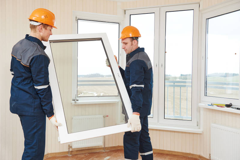 two guys installing a window