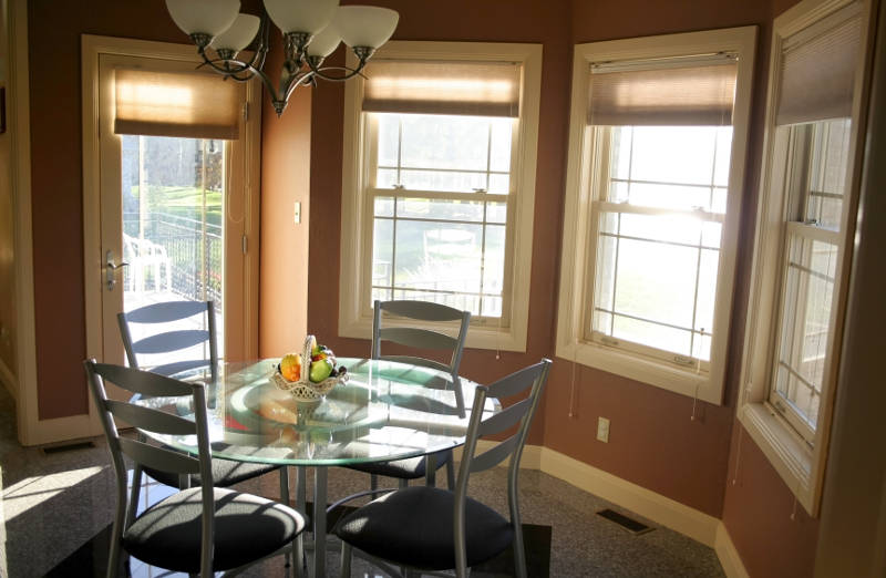 three double hung windows in a dinning room